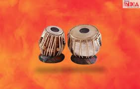 The ghatam is a mud pan with a narrow mouth. Top Indian Musical Instruments Indian Musical Instruments Names With Picutres