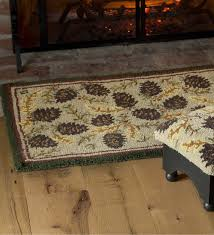 delivered plow and hearth rugs wool pine cone rug with border 2 x 4 accent fancy