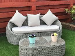 grey rattan sofa and table