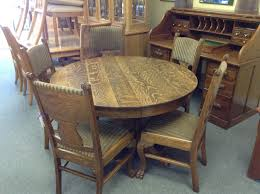 oak dining set round quarter sawn oak table includes 1 captains chair and 4