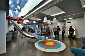 google slide in office. the ticket sales company designed office to prioritise socialising its standout feature is a metal slide google in f