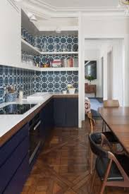 steel kitchen cabinets brick wall
