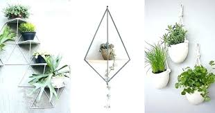 wall mounted flower pot holder wall mounted plant pots holders here are examples of modern and stylish wall mounted planters that will help you get indoor
