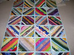 Oz Comfort Quilts - Flood and Earthquake Relief Quilts &  Adamdwight.com