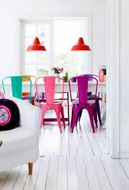 paint your dining chairs for an instant update to your kitchen this easy diy will brighten your eating space in a snap painted chairs add an unexpected
