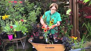 how to plant a flower garden. Garden Tips : How To Plant Flowers In A Wheelbarrow \u0026 Other Whimsical Items Your - YouTube Flower