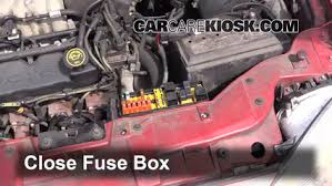 replace a fuse 1996 1999 ford taurus 1997 ford taurus gl 3 0l 6 replace cover secure the cover and test component
