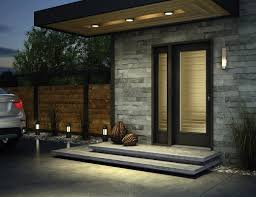 modern black steel entry door on a brick home