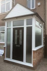 black posite door and upvc porch