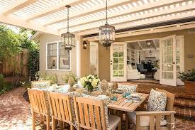 outdoor terrace lighting. Exterior Lighting Ideas Rustic Lanterns Complete A Beautiful And Inviting Outdoor Dining Space Design Moon Christmas Terrace