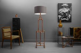 loft style floor lamp made of copper pipes in trendy hipster apartment