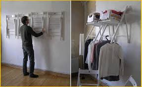 hang folding chairs on the wall for instant shelf and clothes rack