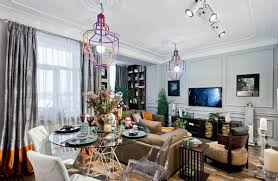 interior decorating in eclectic style with unique lighting fixtures and  french paintings