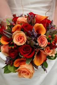 fall flowers wedding. fall bridal bouquet. gorgeous reds, oranges, pinks, and greens! flowers of wedding