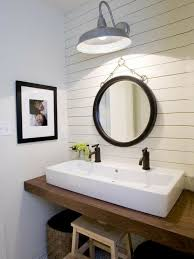 coastal powder room design with paneled accent wall chunky wood floating bathroom vanity rectangular bathroom sink lighting