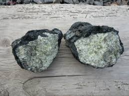 this gem is inside the black lava rocks what looks from the outside just to be an ordinary black rock can have a beautiful green middle just waiting
