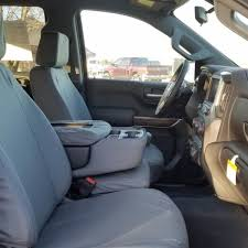 front seat of a 2019 chevy silverado 1500 with gray tigertough seat covers