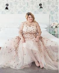 picture of blush wedding dress with a sheer bodice and rose gold