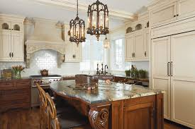 an italian styled kitchen shows off carved corbels a heavily veined granite