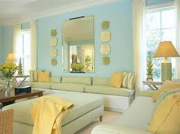 living room yellow living room with blue wall and white curtain and table and floor