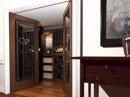 view into a small closet converted into a small wine room showing vint kit and custom
