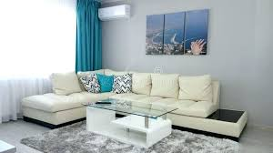 small apartment living room design idea leather couch dressing coffee table therapy spaces editorial photo