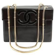 chanel vintage black leather snake chain bag for