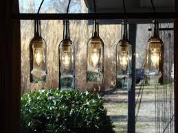 wine bottle light fixture so cool for a basement bar would be in bottle chandelier kit
