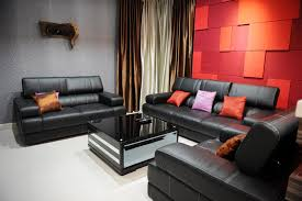 red room with black furniture. bright red and orange accent wall in living room with black leather furniture t