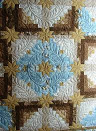 Free Motion Quilting Designs For Log Cabin Log Cabin Stars Quilt Quilted By Quilt Vine Feather Wreath