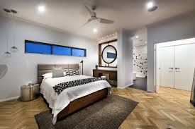 ceiling fan on white ceiling in awesome bedroom ideas design with recessed lights and upholstered headboard also wooden flooring with wall is painted in