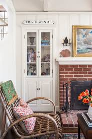 superb curio cabinet in beach style orange county with painting stone fireplace next to built in closet alongside tile over brick