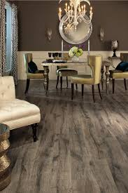 armstrong laminate flooring with chandelier and candle sconces also silver  dining table for modern dining room