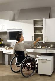 Lowered Kitchen Cabinet Accessed By Woman In Wheelchair Amazing Ideas