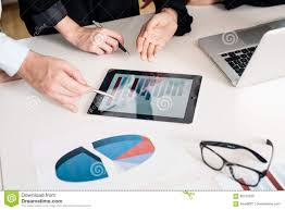 Professional Stock Chart For Pc Professional Team Analyzing Bar Chart Displayed On Tablet Pc