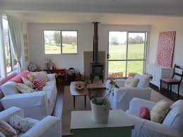 small living room design ideas. Living Room : A Comfortable Decorate Small Ideas With Couchs And Wooden Table Also White Red Painting, Pink Flowers Furnace Design