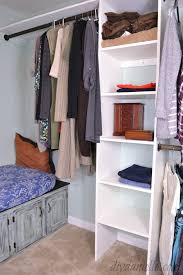 built in closet organization system multiple shelves a seating area