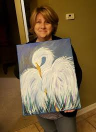 recently one reddit user shared a picture of his mother holding her painting