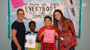 two take top honors in local veterans essay contest copiague news from left susan e wiley elementary school principal cynthia florio town of babylon s veterans awareness week essay contest essay winners hunter