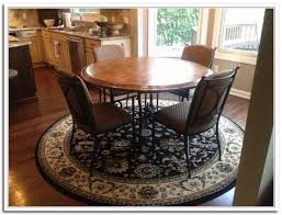 image of area rug under round dining table size