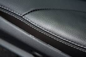 up close view of leather upholstery on a car seat