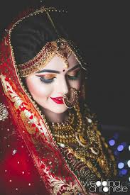 neha makeup artistry delhi suggests this fiery sunset inspired red and golden shaded eye makeup is perfect for a spin on the traditional indian bridal