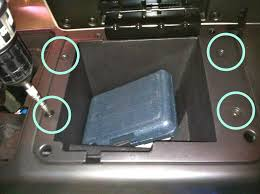 car audio tips tricks and how to s hummer h2 stereo removal open the center consol and take out the four phillips screws holding the main liner of the center consol compartment in place then take out the plastic