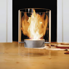 the ponton fireplace by wolf udo wagner uses fire resistant glass stainless steel and burns bioalcohol