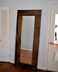 leaned wooden framed wall mirror in extra large part of furniture