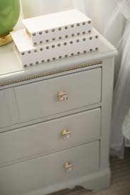 Refinished Furniture With Gray Paint And New Gold And Crystal Hardware