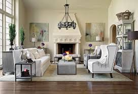 by not building custom wall units on each side of the fireplace the client can spend a larger portion on furniture chandeliers floor lamps art