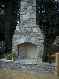 outdoor stone fireplace this outdoor fireplace in makes this deck feel more like an outdoor living outdoor stone fireplace