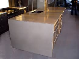 taupe concrete kitchen island countertop with waterfall ends