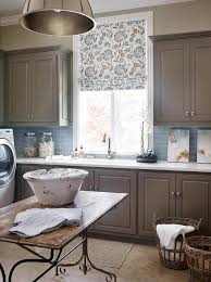 gray laundry room cabinets with white quartz countertops